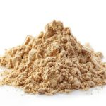 heap of maca powder isolated on white